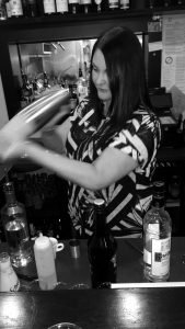Staff preparing a cocktail, shaken not stirred