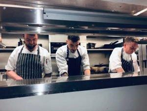 Three chefs plating up
