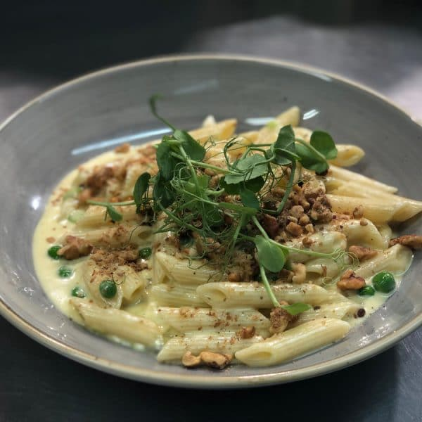 Cashel Blue Cheese Penne Pasta, Roasted Salted Walnut Spring Peas, Scallions, Pea Shoot, White Wine Cream (V)